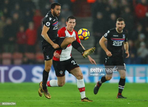 Andros Townsend of Crystal Palace is challenged by PierreEmile Hojbjerg of Southampton during the Premier League match between Southampton and...