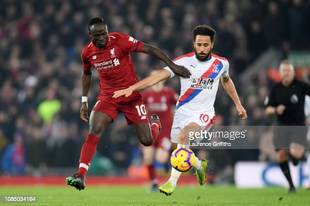 Andros Townsend of Crystal Palace is challenged by Sadio Mane of Liverpool during the Premier League match between Liverpool FC and Crystal Palace at...