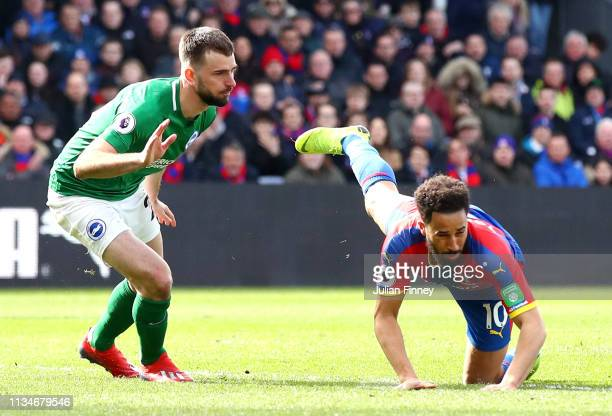 Andros Townsend of Crystal Palace is fouled by Davy Proepper of Brighton and Hove Albion and a penalty is awarded during the Premier League match...