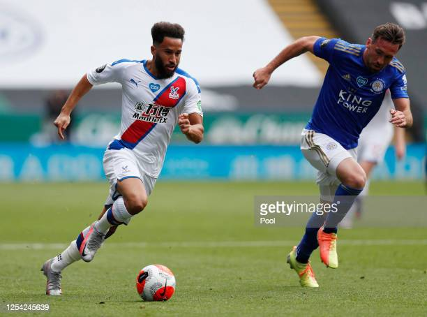Andros Townsend of Crystal Palace runs with the ball past Christian Fuchs of Leicester City during the Premier League match between Leicester City...
