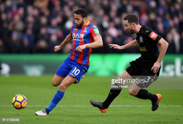 Andros Townsend of Crystal Palace runs with the ball under pressure from Paul Dummett of Newcastle United during the Premier League match between...