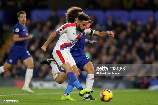 Andros Townsend of Crystal Palace scores his team's first goal under pressure from David Luiz of Chelsea during the Premier League match between...
