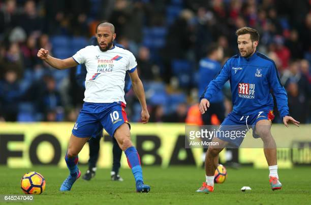 Andros Townsend of Crystal Palace warms up while wearing a Pride and Palace shirt with Yohan Cabaye of Crystal Palace during the Premier League match...