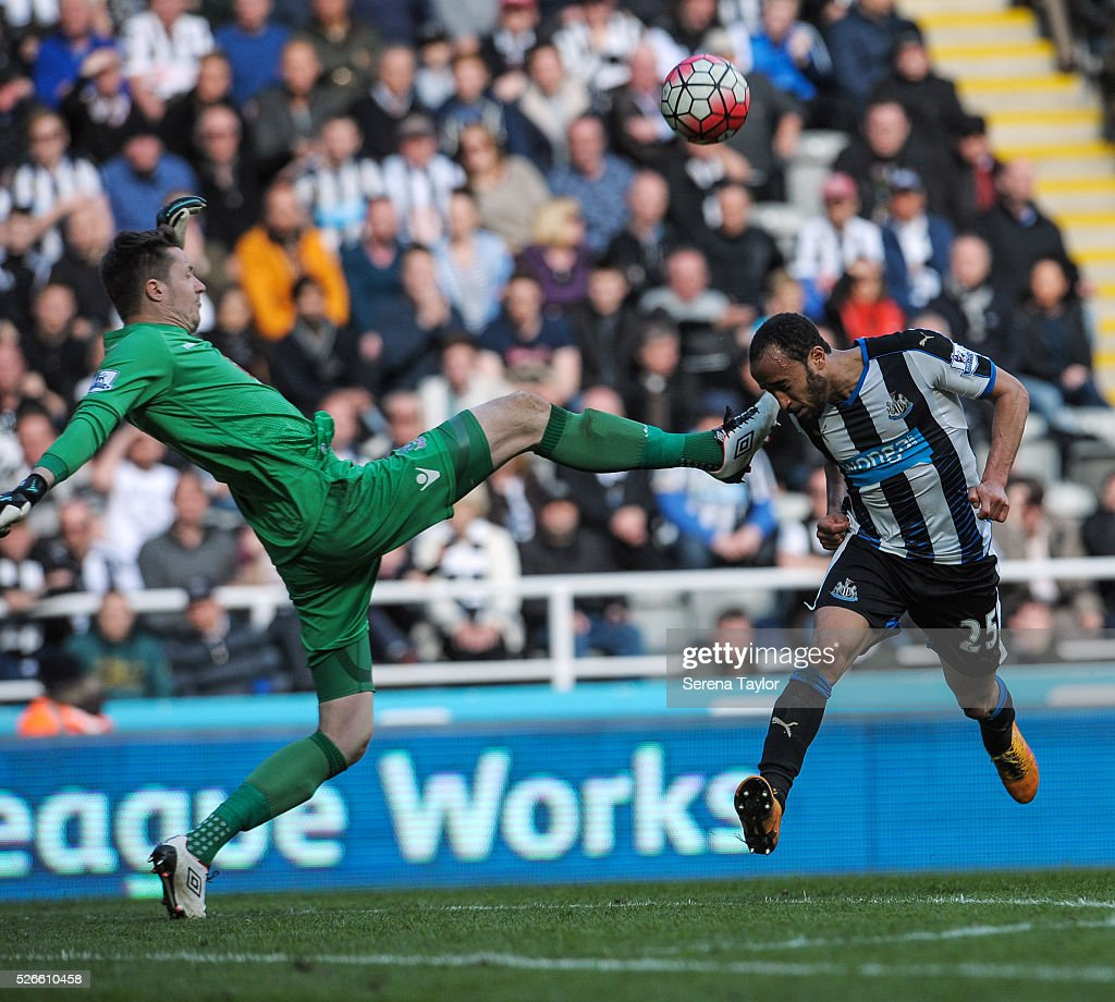 Andros Townsend of Newcastle (R) attempts to head the ball whilst Crystal Palace Goalkeeper Wayne Hennessy (L) stretches his foot out to clear almost coming into contact with Townsend during the Barclays Premier League match between Newcastle United and Crystal Palace at St.James' Park on April 30, 2016, in Newcastle upon Tyne, England.