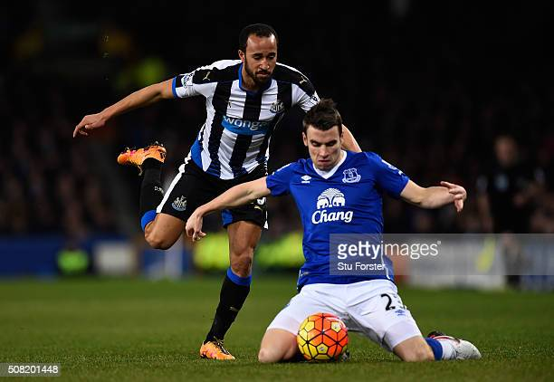 Andros Townsend of Newcastle united challenges Seamus Coleman of Everton during the Barclays Premier League match between Everton and Newcastle...