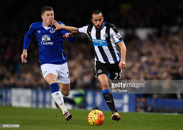 Andros Townsend of Newcastle united is challenged by Ross Barkley of Everton during the Barclays Premier League match between Everton and Newcastle...