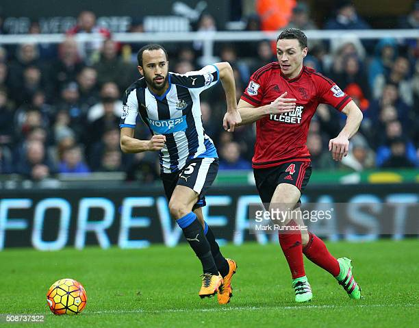 Andros Townsend of Newcastle United is tracked by James Chester of West Bromwich Albion during the Barclays Premier League match between Newcastle...