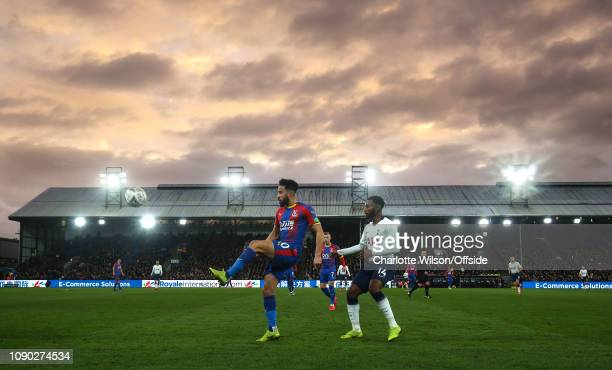 Andros Townsend of Palace' and GeorgesKevin Nkoudou of Tottenham beneath a moody evening sky at Selhurst Park during the FA Cup Fourth Round match...