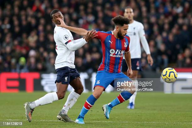 Andros Townsend of Palace pushes his fingers into the face of Georginio Wijnaldum of Liverpool during the Premier League match between Crystal Palace...
