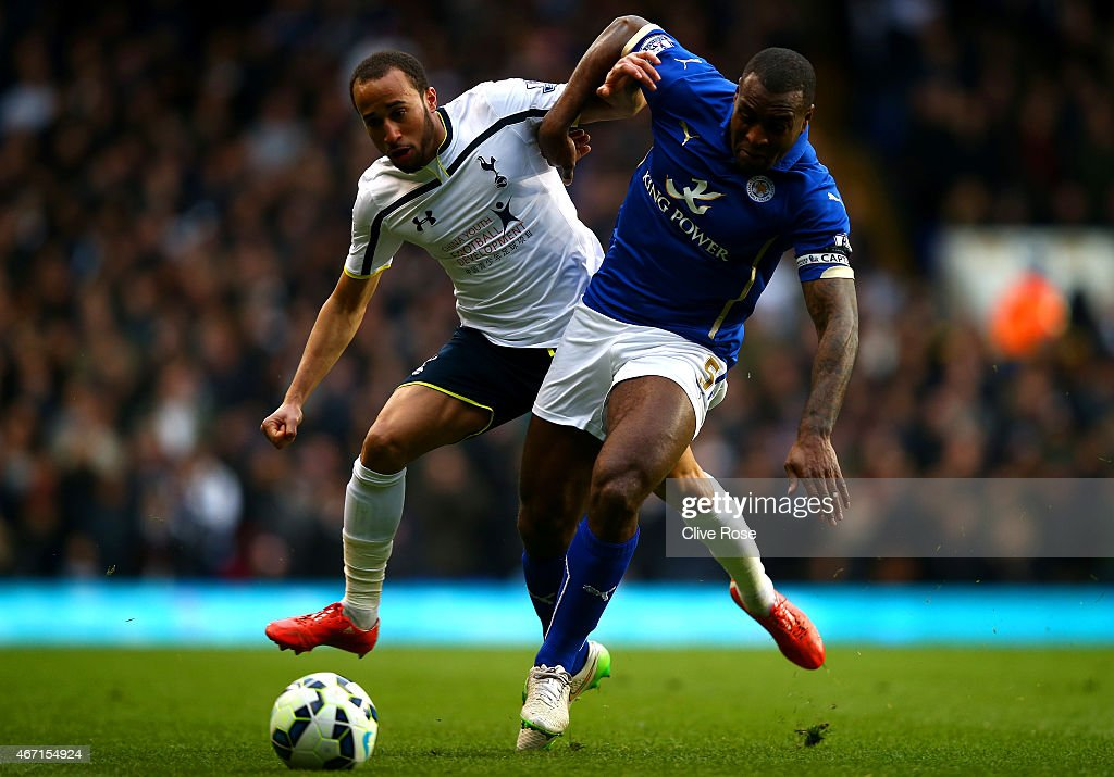 Andros Townsend of Spurs battles for the ball with Wes Morgan of Leicester City during the Barclays Premier League match between Tottenham Hotspur and Leicester City at White Hart Lane on March 21, 2015 in London, England.