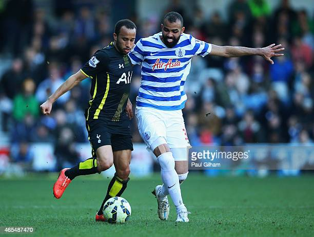 Andros Townsend of Spurs battles with Sandro of QPR during the Barclays Premier League match between Queens Park Rangers and Tottenham Hotspur at...