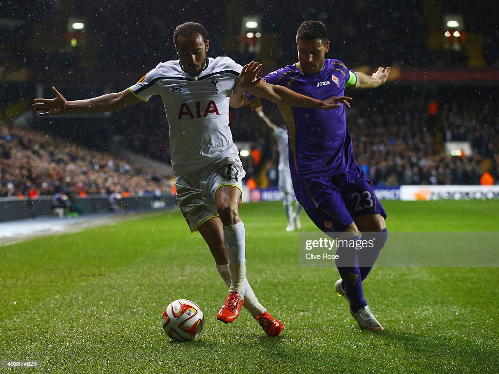 Andros Townsend of Spurs holds off Manuel Pasqual of Fiorentina during the UEFA Europa League Round of 32 first leg match between Tottenham Hotspur FC and ACF Fiorentina at White Hart Lane on February 19, 2015 in London, United Kingdom.