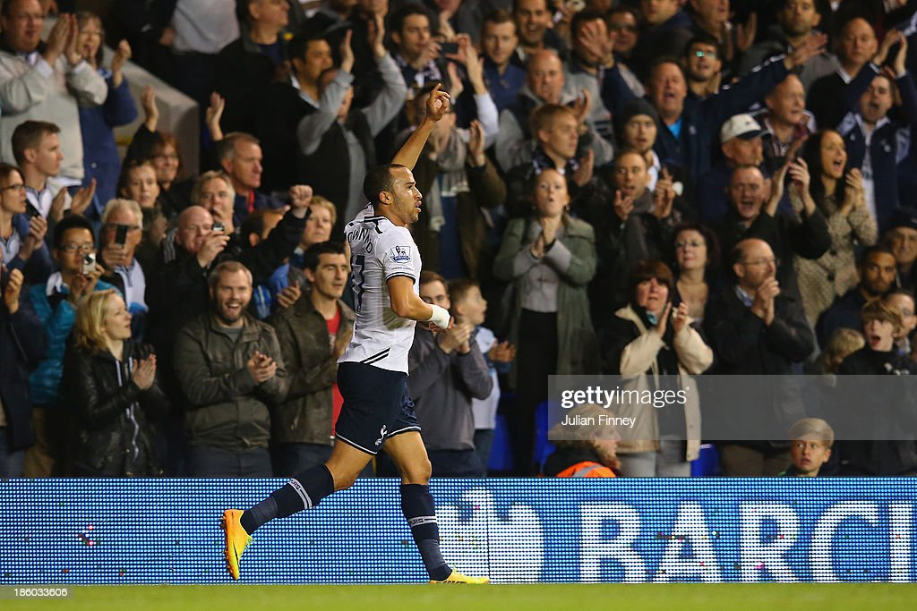 Andros Townsend of Spurs returns to the pitch after falling into a photo pit during the Barclays Premier League match between Tottenham Hotspur and Hull City at White Hart Lane on October 27, 2013 in London, England.