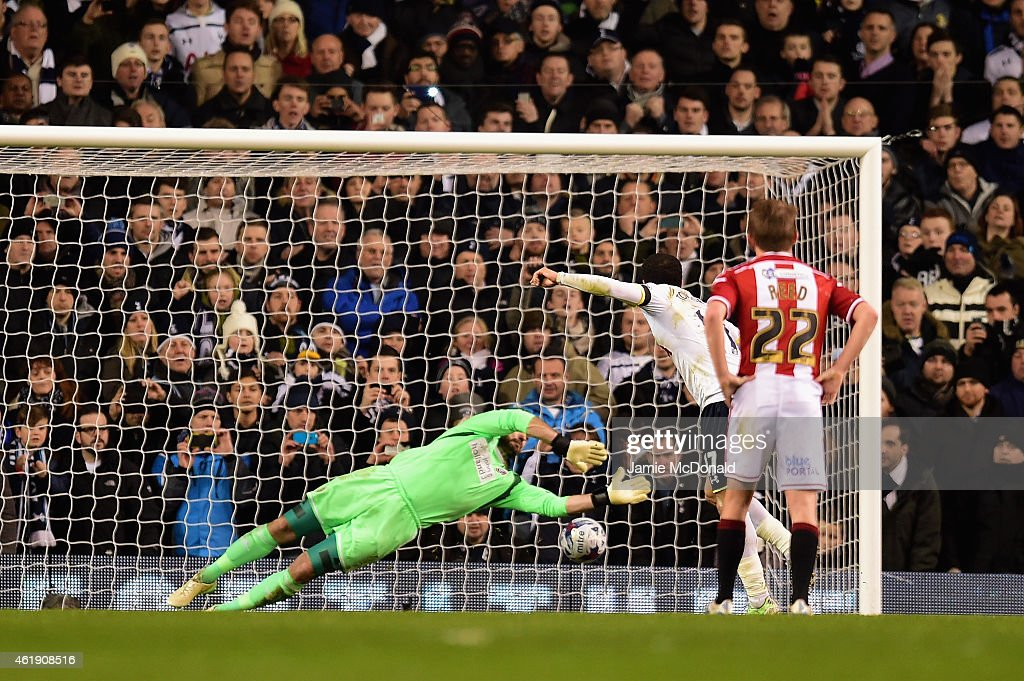 Andros Townsend of Spurs scores the opening goal past Mark Howard of Sheffield United from the penalty spot during the Capital One Cup Semi-Final first leg match between Tottenham Hotspur and Sheffield United at White Hart Lane on January 21, 2015 in London, England.