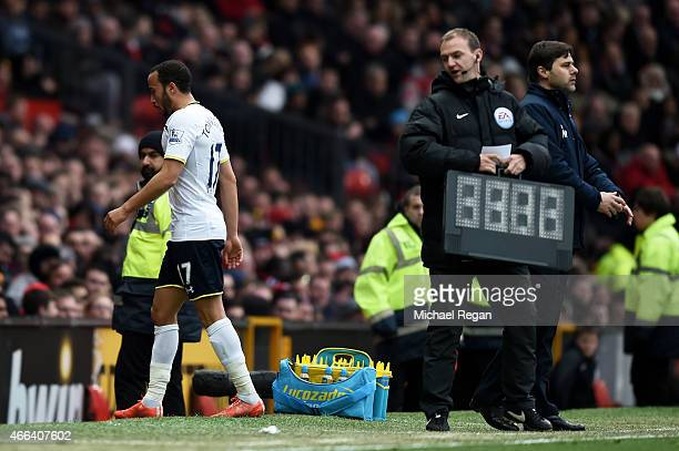 Andros Townsend of Spurs walks off the pitch after being substituted by Mauricio Pochettino the manager of Spurs following a torrid opening period...