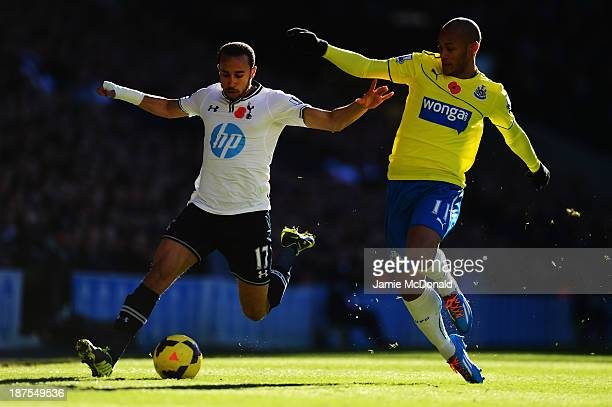 Andros Townsend of Tottenham Hotspur holds off the challenge of Yoan Gouffran of Newcastle United during the Barclays Premier League match between...
