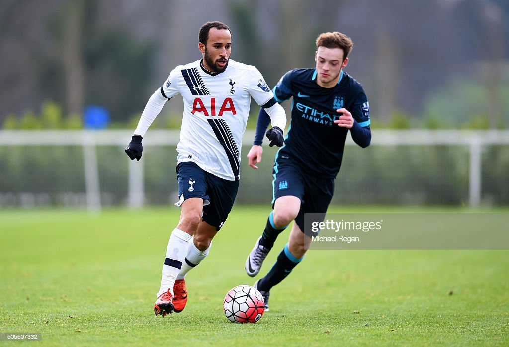 Andros Townsend of Tottenham Hotspur runs with the ball under pressure from Brandon Barker of Manchester City during the Barclays U21 Premier League match between Tottenham Hotspur and Manchester City at Tottenham Hotspur Training Centre on January 18, 2016 in Enfield, England.