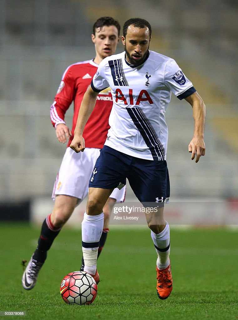 Andros Townsend of Tottenham Hotspur U21 beats William Keane of Manchester United U21 during the Barclays U21 Premier League match between Manchester United U21 and Tottenham Hotspur U21 at Leigh Sports Village on January 4, 2016 in Leigh, Greater Manchester.