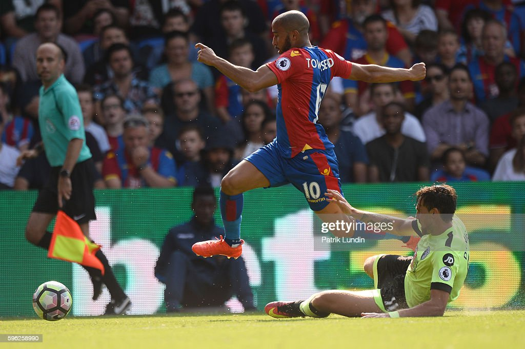Androw Townsend of Crystal Palace jump over a tackle by Charlie Daniels of Bournemouth during the Premier League match between Crystal Palace and Bournemouth at Selhurst Park on August 27, 2016 in London, England.
