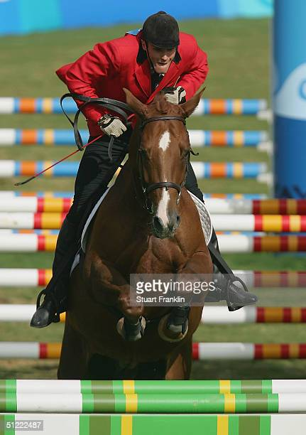 Andrrejus Zadneprovskis of Lithuania rides Zizi Di Villanova in the men's riding event of the modern pentathlon on August 26 2004 during the Athens...