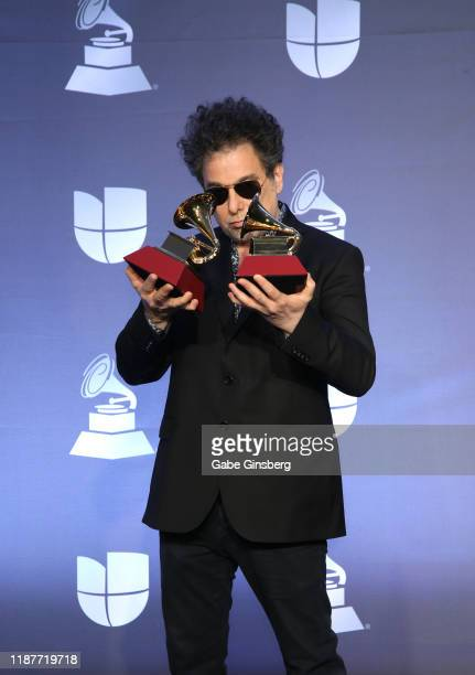 Andrés Calamaro, winner of Best Rock Song and Best Pop/ Rock Album awards, poses in the press room during the 20th annual Latin GRAMMY Awards at MGM...