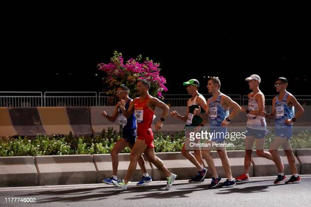 Andrés Chocho of Ecuador and Wenbin Niu of China compete in the Men's 50 Kilometres Race Walk final on day two of 17th IAAF World Athletics...