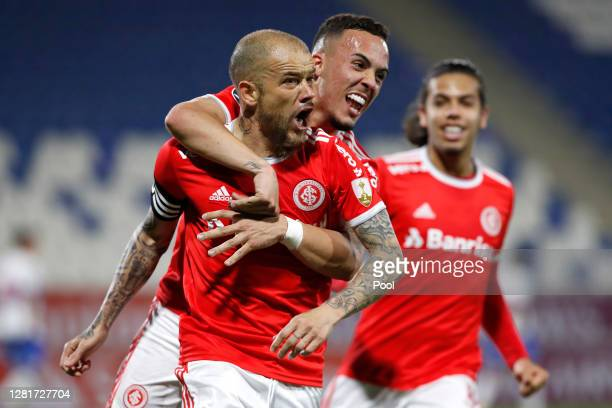 Andrés D'Alessandro of Internacional celebrates with teammate after scoring the first goal of his team during a Group E match of Copa CONMEBOL...