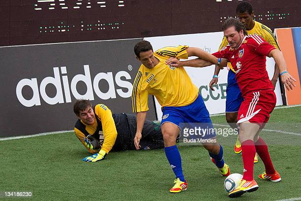 Andrés Guglielminpietrofrom Argentina dribles in front of Brazilian players during a match as part of the the Soccerex Legends fiveaside Tournament...