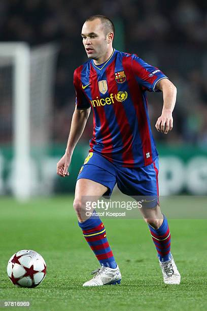Andrés Iniesta of Barcelona runs with the ball during the UEFA Champions League round of sixteen second leg match between FC Barcelona and VfB...