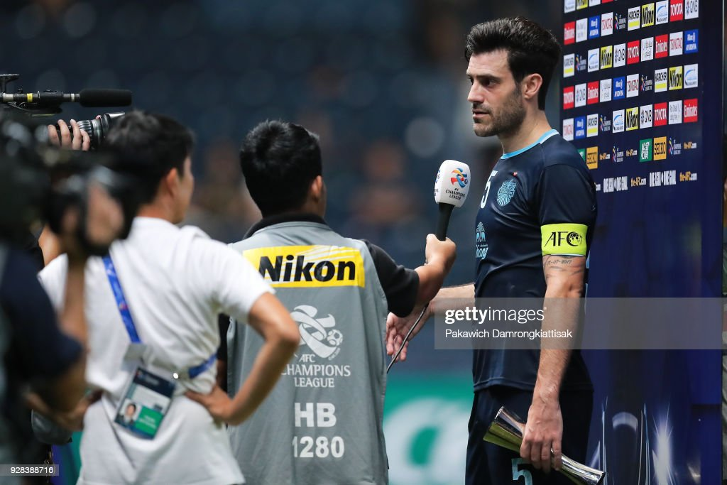 Andrés Túñez #5 of Buriram United FC (R) gives interview after received man of the match award during the AFC Champions League Group G match between Buriram United Football Club and Cerezo Osaka at Thunder Castle on March 6, 2018 in Buriram, Thailand.