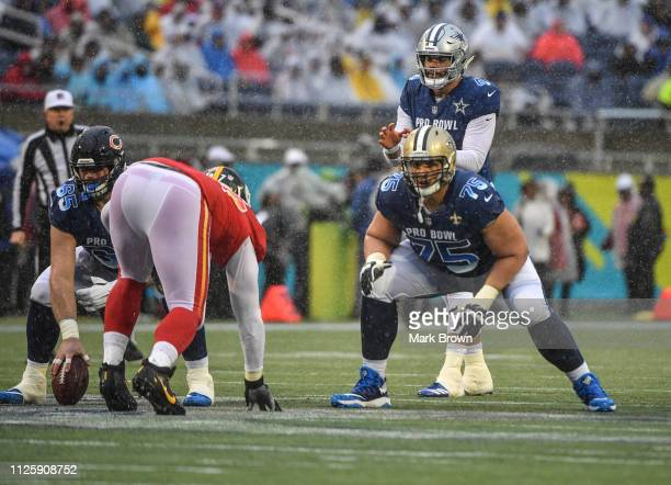 Andrus Peat of the New Orleans Saints blocks for Dak Prescott of the Dallas Cowboys during the 2019 NFL Pro Bowl at Camping World Stadium on January...