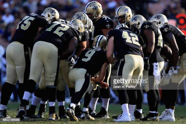 Andrus Peat , Zach Line, Terron Armstead, Ryan Ramczyk and Drew Brees of the New Orleans Saints huddle during the second half of a game at Los...