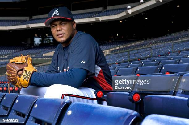 Andruw Jones center fielder for the Atlanta Braves poses for a photo with his Mizuno glove at Turner Field in Atlanta Georgia Wednesday June 27 2007...