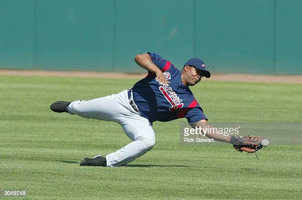 Andruw Jones of the Atlanta Braves can't quite make the diving catch against the Houston Astros on March 6 2004 at Osceola County Stadium in...