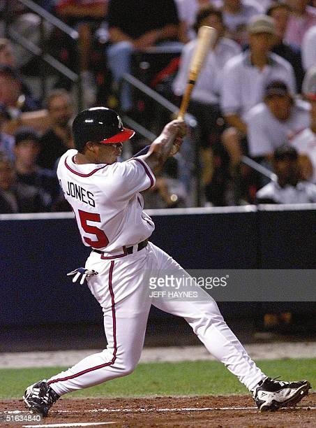 Andruw Jones of the Atlanta Braves connects on his 3rd inning solo home run against the San Diego Padres 07 October during Game 1 of the National...