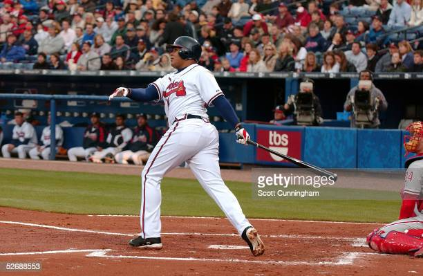 Andruw Jones of the Atlanta Braves follows through on a first inning three-run home run against the Philadelphia Phillies at Turner Field on April...