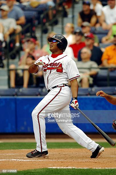 Andruw Jones of the Atlanta Braves follows through on the game winning home run against the Baltimore Orioles at Turner Field on June 25 2005 in...