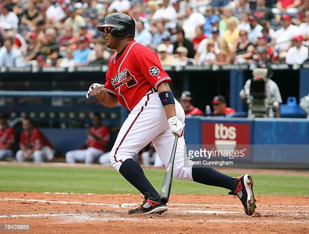Andruw Jones of the Atlanta Braves hits against the Pittsburgh Pirates at Turner Field July 15 2007 in Atlanta Georgia The Braves defeated the...