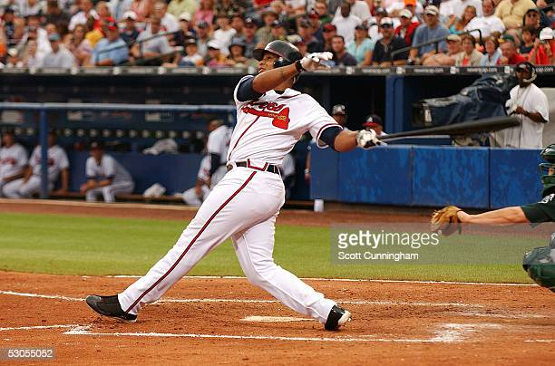 Andruw Jones of the Atlanta Braves hits his second tworun home run of the game against the Oakland Athletics at Turner Field on June 11 2005 in...