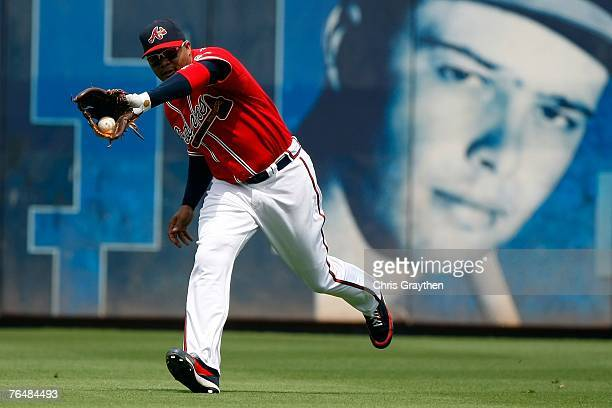 Andruw Jones of the Atlanta Braves makes a catch in the outfield against the New York Mets at Turner Field September 2 2007 in Atlanta Georgia The...