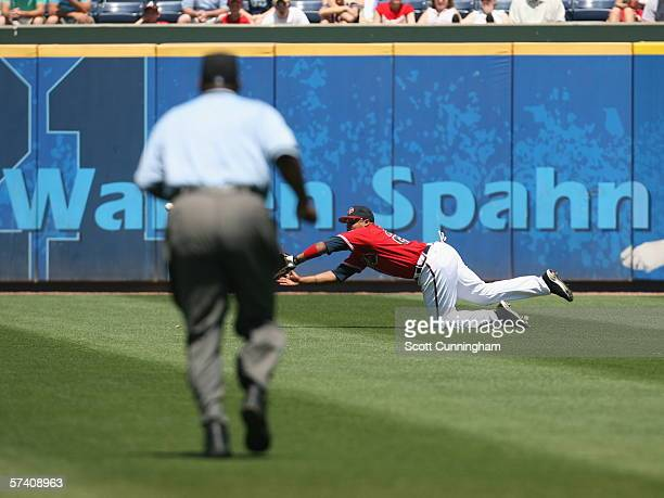 Andruw Jones of the Atlanta Braves makes a diving catch against the San Diego Padres at Turner Field on April 16 2006 in Atlanta Georgia The Padres...