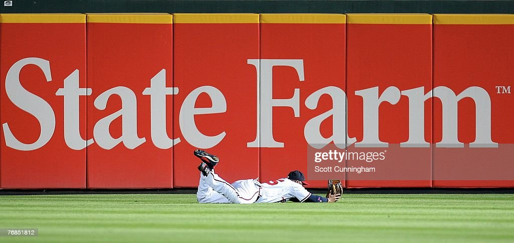 Andruw Jones #25 of the Atlanta Braves makes a diving catch against the Florida Marlins at Turner Field on September 18, 2007 in Atlanta, Georgia. The Braves defeated the Marlins 4-3.