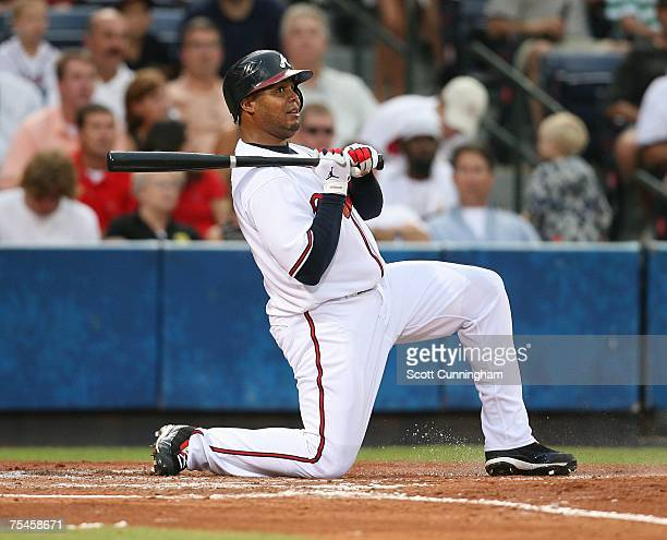 Andruw Jones of the Atlanta Braves reacts after fouling off a pitch against the Cincinnati Reds at Turner Field on July 17 2007 in Atlanta Georgia...