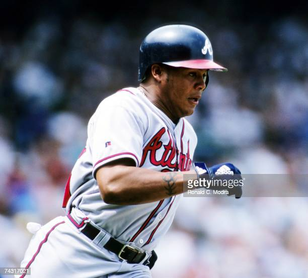 Andruw Jones of the Atlanta Braves running to first base during a game against the Chicago Cubs in Wrigley Field in May 1999 in Chicago Illiinios