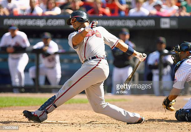 Andruw Jones of the Atlanta Braves swings at the pitch against the New York Mets during their game at Shea Stadium on April 21 2007 in Flushing New...