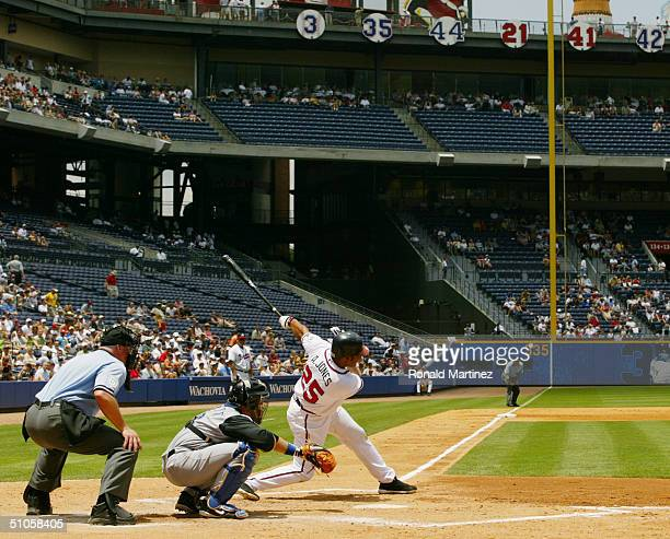 Andruw Jones of the Atlanta Braves swings at the pitch during the game against the Kansas City Royals at Turner Field on June 17 2004 in Atlanta...