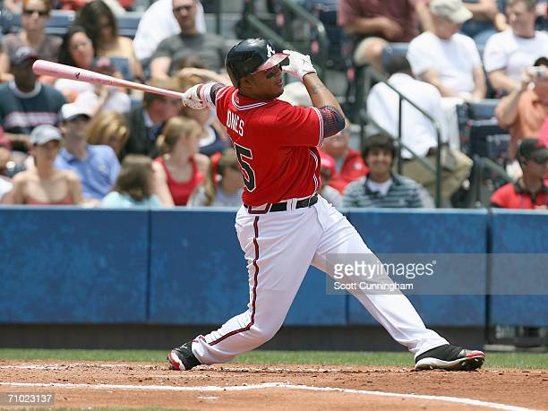 Andruw Jones of the Atlanta Braves swings at the pitch with a pink bat in honor of Mothers Day during the game against the Washington Nationals at...