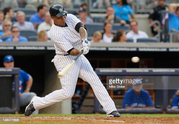 Andruw Jones of the New York Yankees hits a threerun homer in the secondinning against the Toronto Blue Jays at Yankee Stadium on July 17 2012 in the...