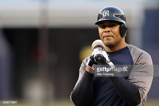 Andruw Jones of the New York Yankees looks on against the Detroit Tigers during Game One of the American League Championship Series at Yankee Stadium...