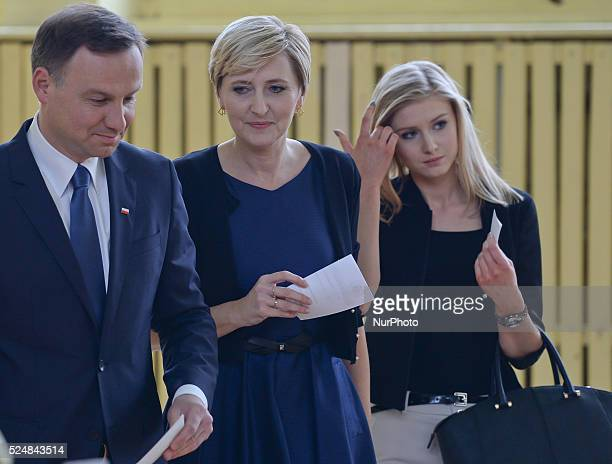 Andrzej Duda becomes the new President of the Republic of Poland pictured as he arrives to casts his vote accompanied by wife Agata Kornhauser and...